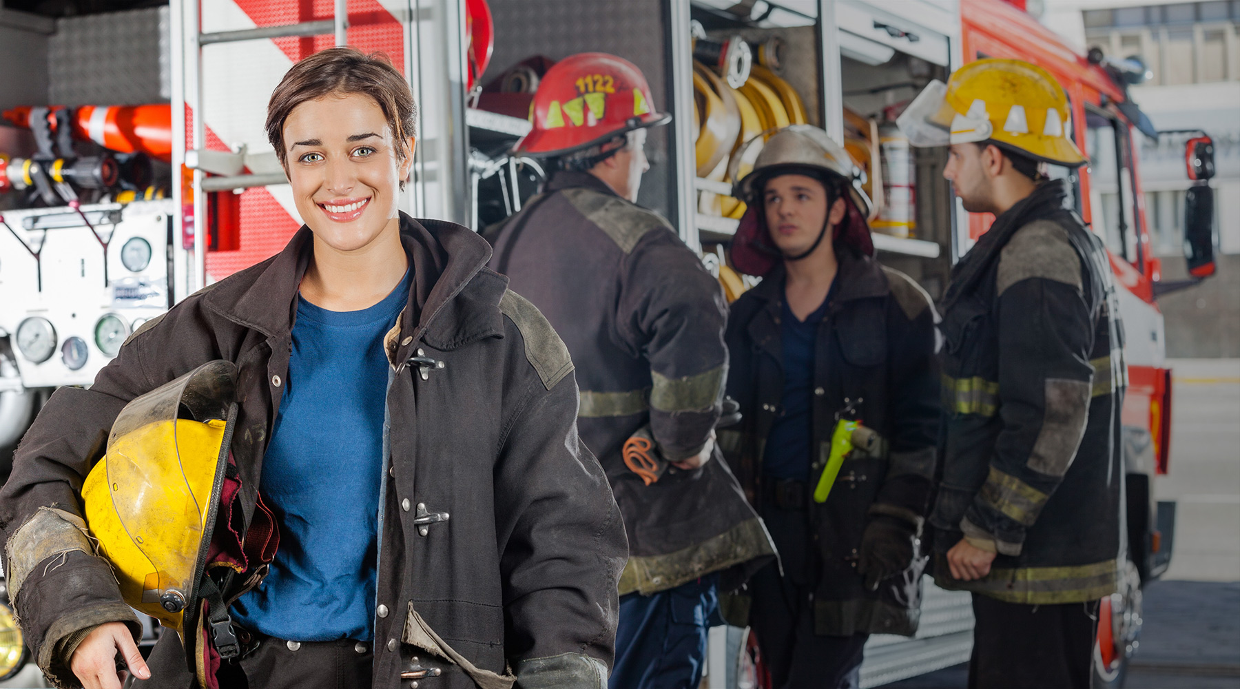 Cimara image of a female firefighter with her response team